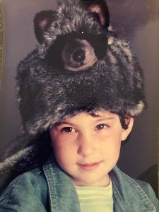 history of Furtastic friends by bocchetta child wearing plush toy hat