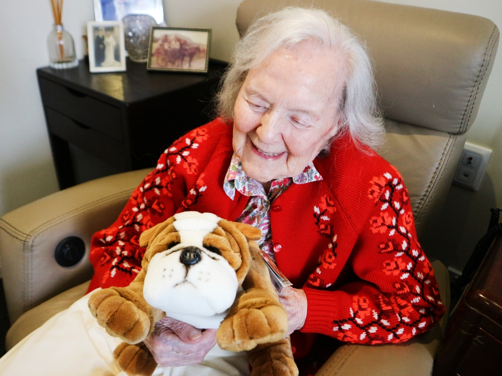 Norma Ford and her Furtastic Friend at Arcare Hope Island